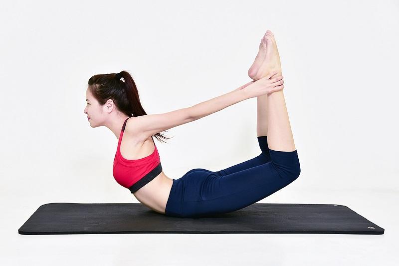 Tư thế cánh cung - Bài tập yoga chữa thoái hóa đốt sống cổ